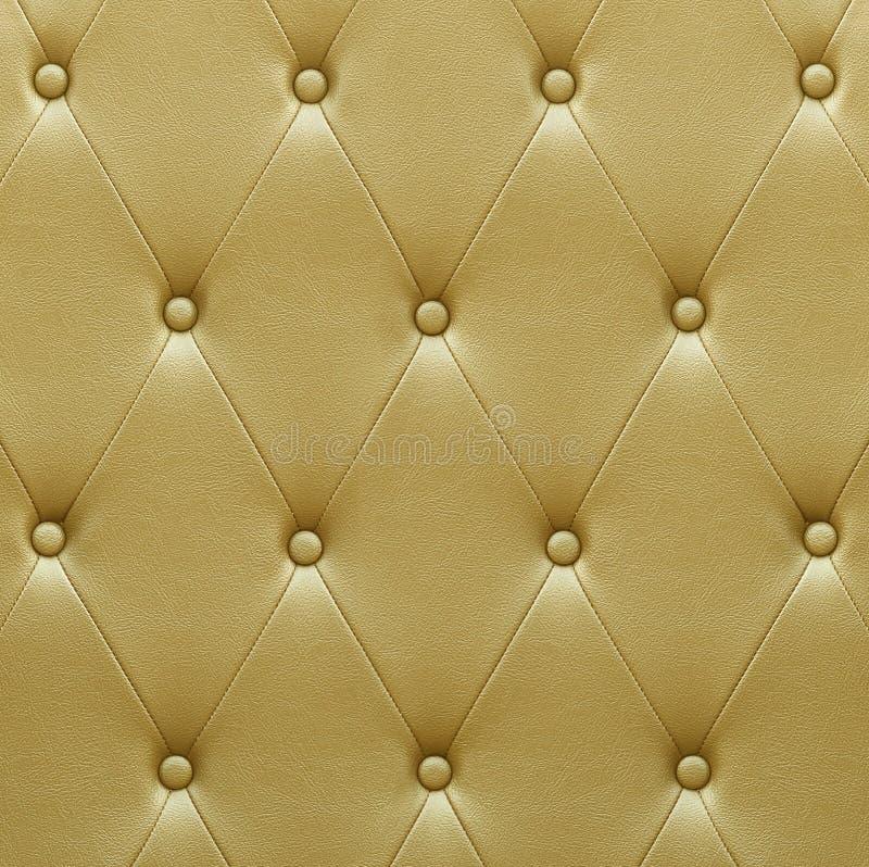 De luxueuze gouden stoffering van de leerzetel stock fotografie