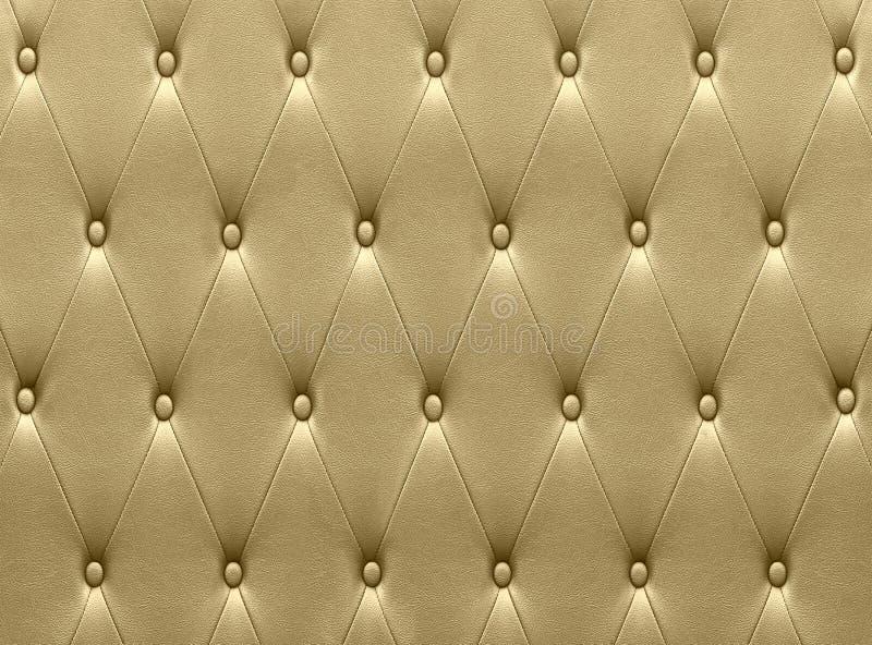 De luxueuze gouden stoffering van de leerzetel stock afbeeldingen