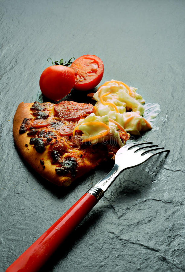 De Maaltijd van de pepperonispizza stock afbeeldingen