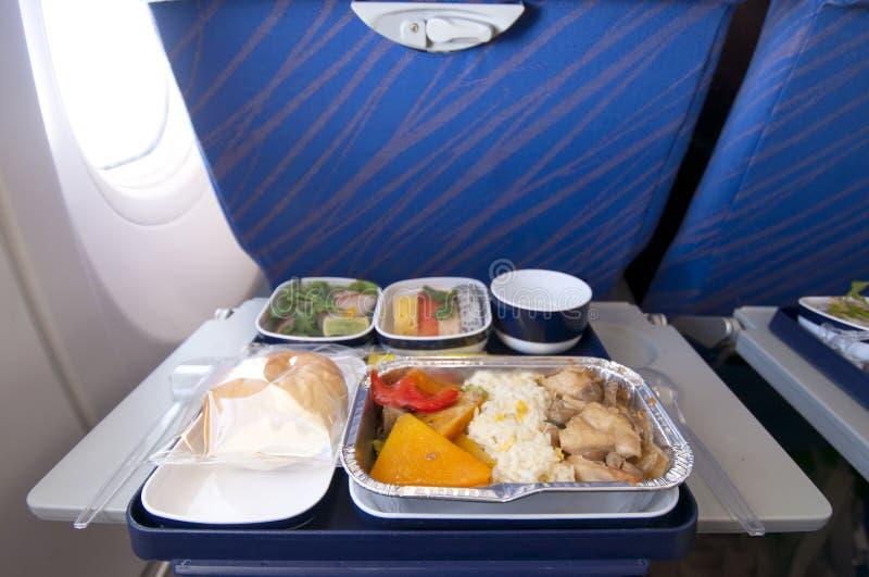 De maaltijd van het vliegtuig stock afbeelding