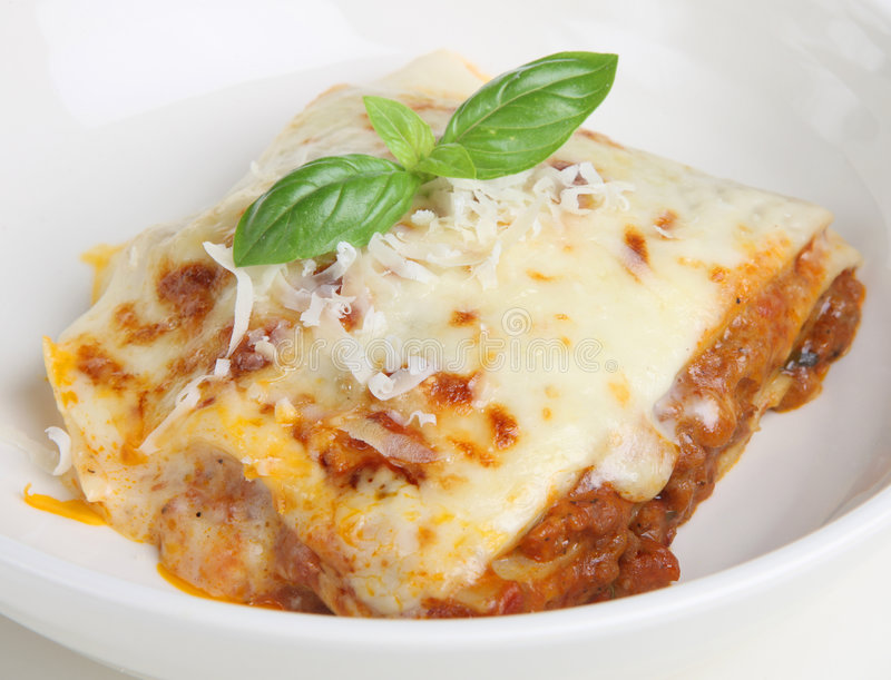 De Maaltijd van lasagna's stock afbeeldingen