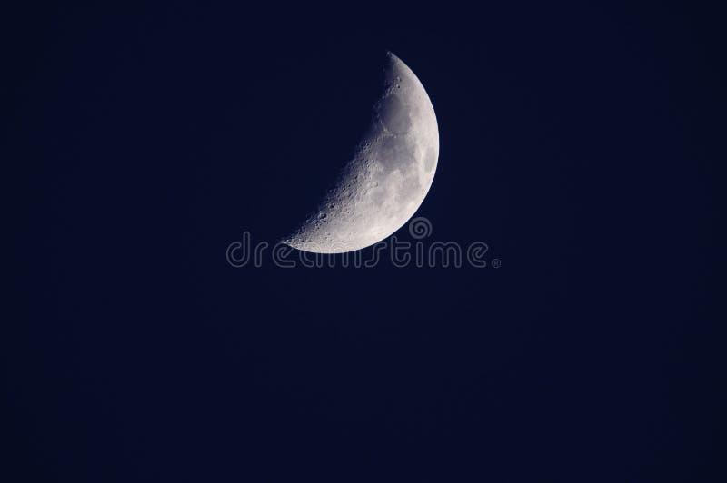 De maan van het kwart stock afbeelding