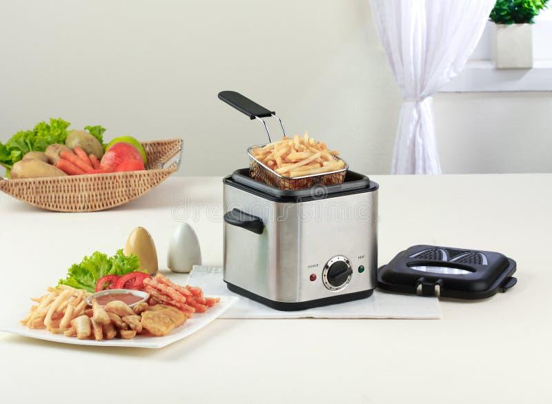 De machine van de frituurpan stock foto's