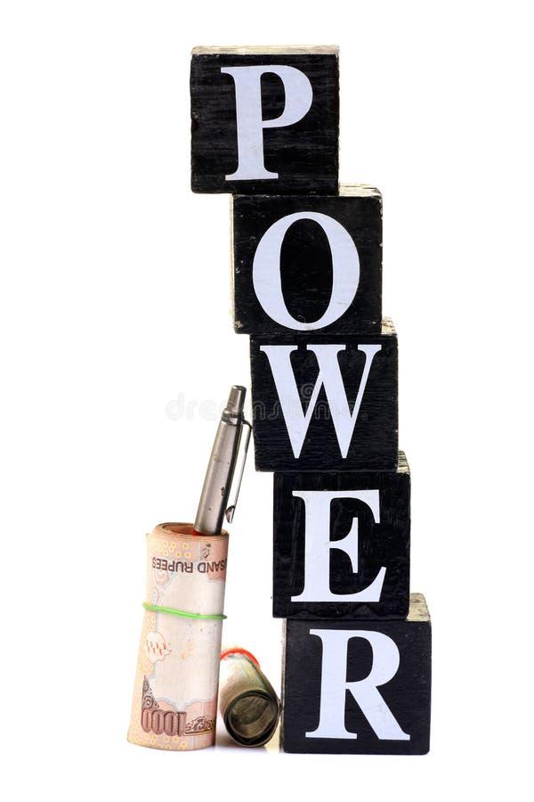 De macht van de pen en van het geld stock afbeeldingen