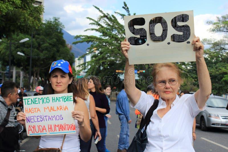 De machtsbesnoeiingen van Venezuela: De protesten breken in Venezuela over elektriciteitspanne uit royalty-vrije stock fotografie