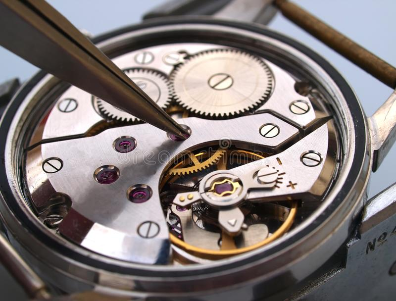 de macro van de horlogebeweging stock afbeeldingen