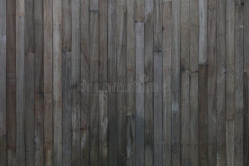 De madera natural rústico texturizada con la pintura oscura para el diseño retro y del vintage del fondo imagen de archivo libre de regalías
