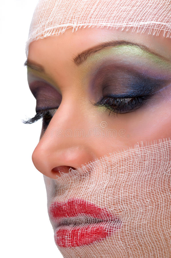 De make-up van het gezicht die met gaas wordt versluierd stock afbeeldingen