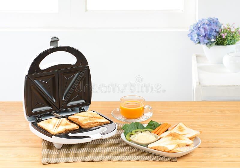 De makerhulpmiddel van de sandwich stock foto's