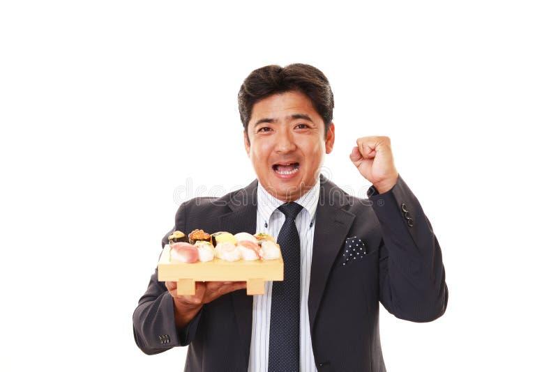 De man die sushi eet royalty-vrije stock fotografie