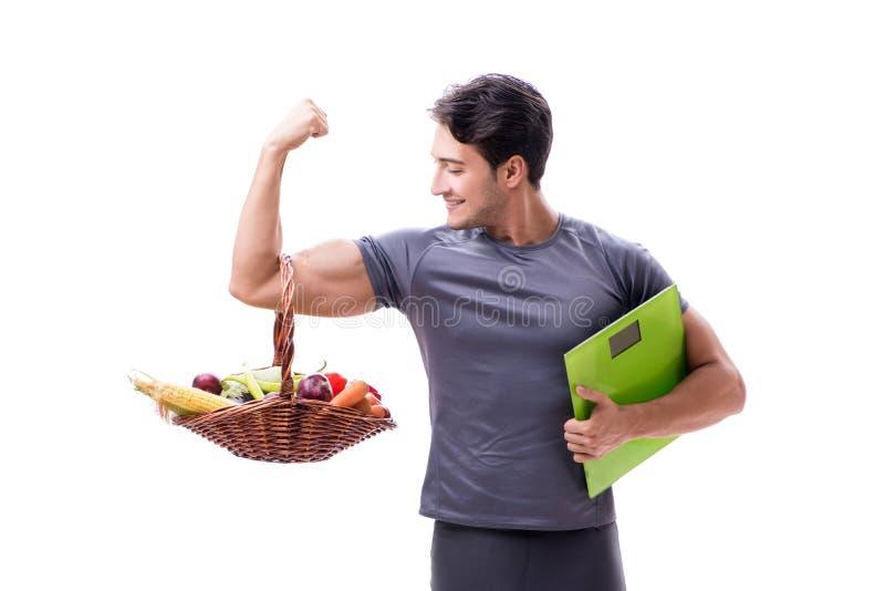 De man die de voordelen van het gezonde eten bevorderen en sporten doen stock foto's