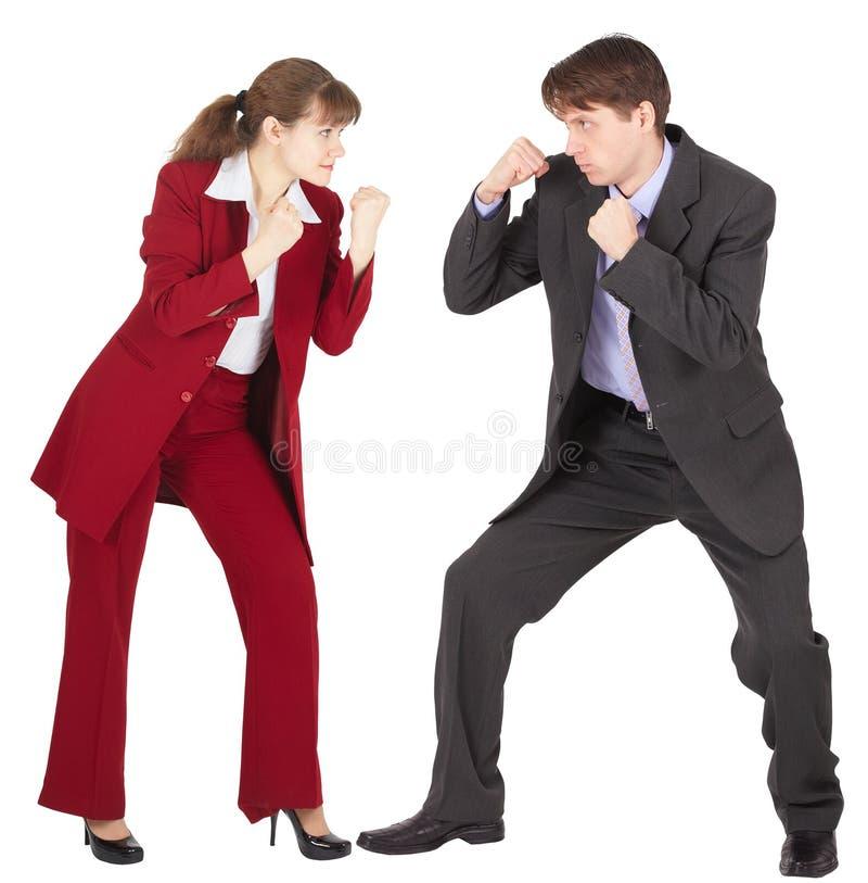 De man en de vrouw in pakken gaan vechten royalty-vrije stock foto's