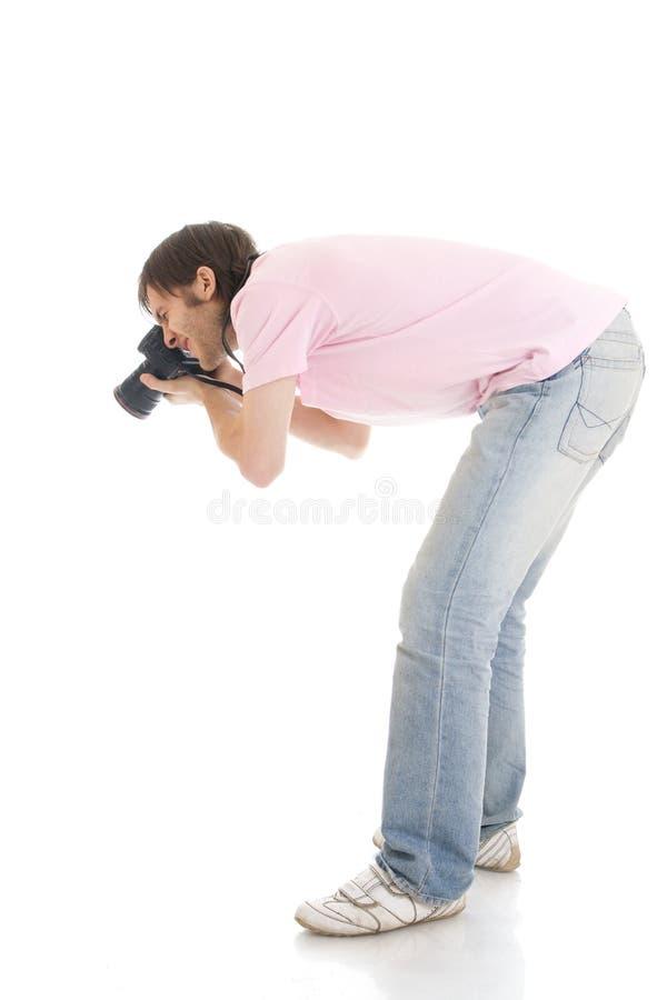 De man met de camera die op een wit wordt geïsoleerd¯ royalty-vrije stock foto