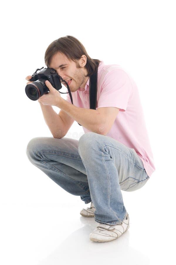 De man met de camera die op een wit wordt geïsoleerdu stock fotografie