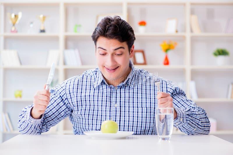 De man op speciaal dieet programm om gewicht te verliezen stock afbeelding