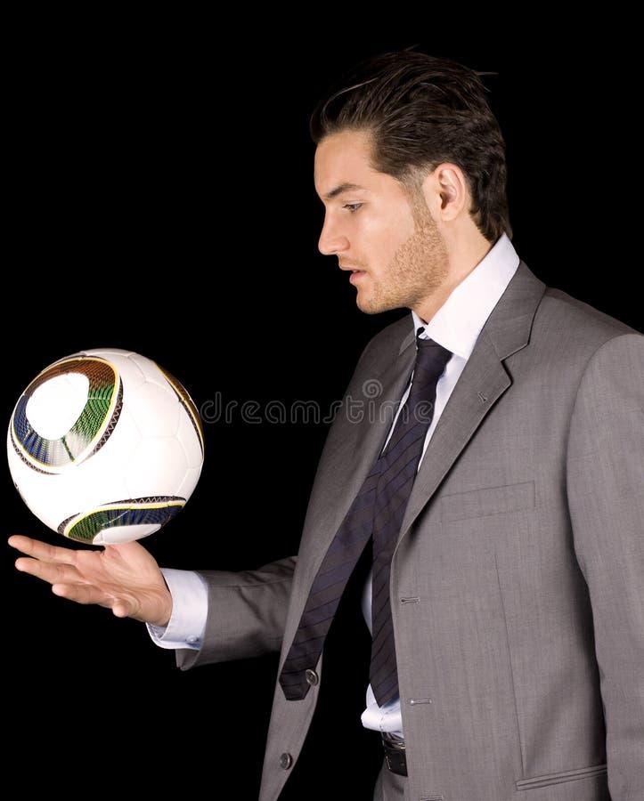 De manager of de speler van het voetbal met bal stock afbeeldingen