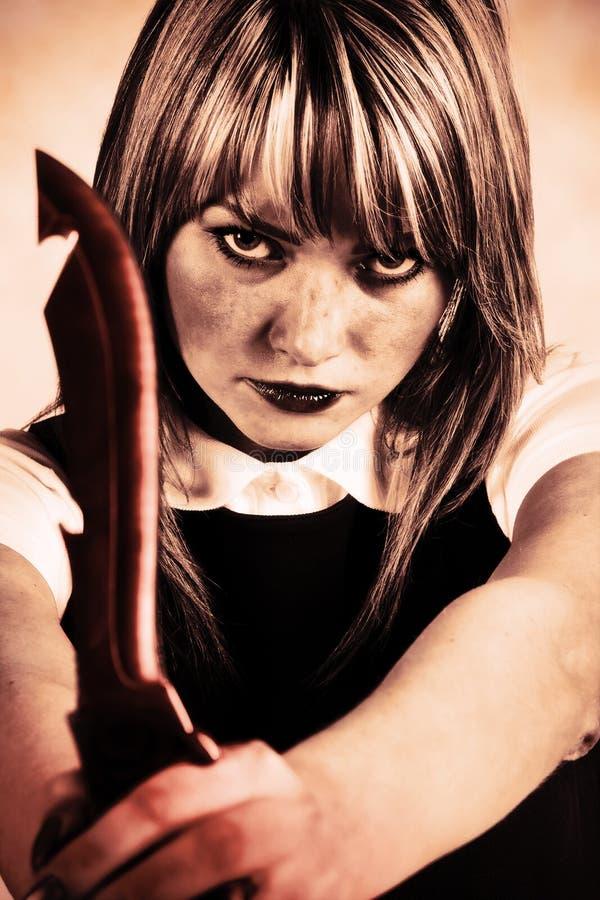 De maniak van de vrouw met mes stock afbeeldingen