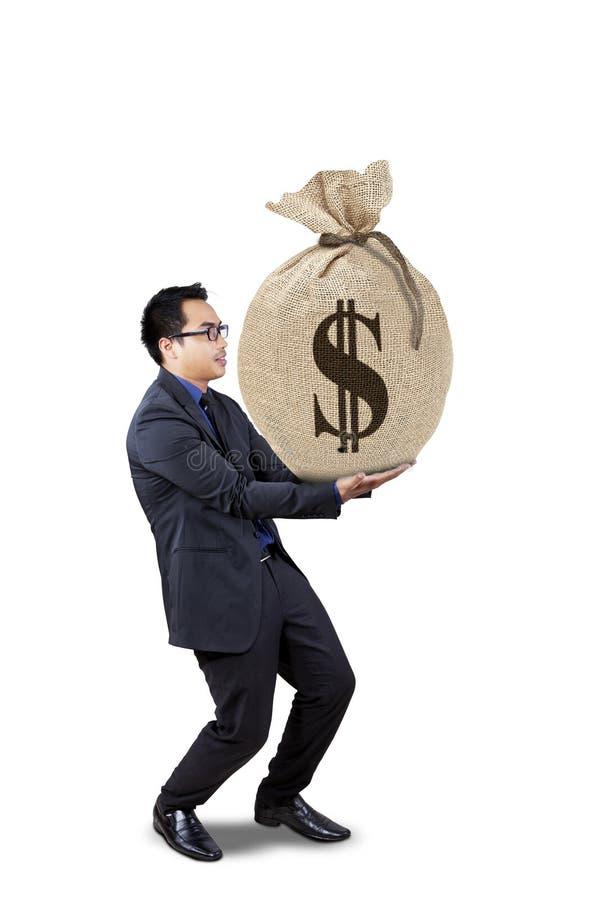 De mannelijke arbeider houdt geldzak royalty-vrije stock afbeelding