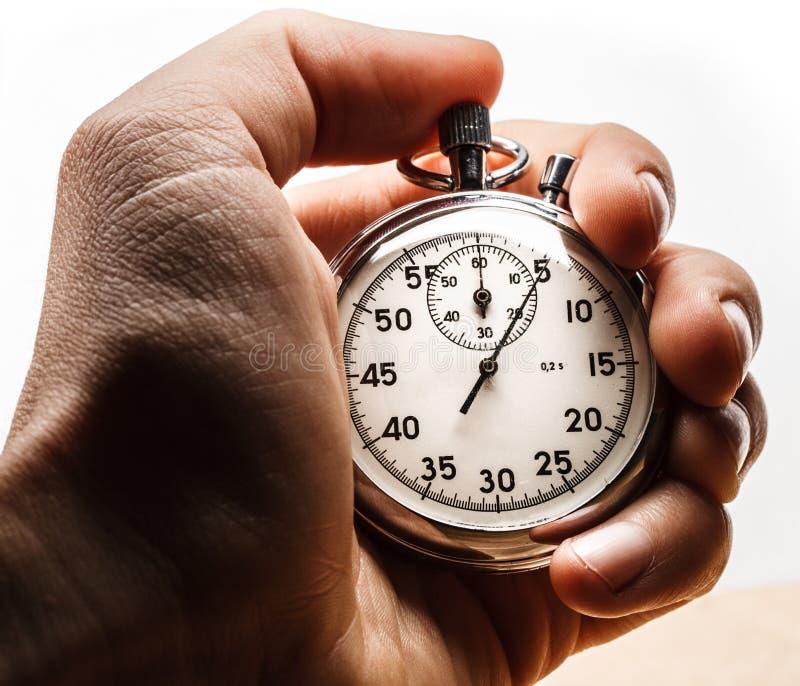 De mannelijke chronometer van de handholding stock foto
