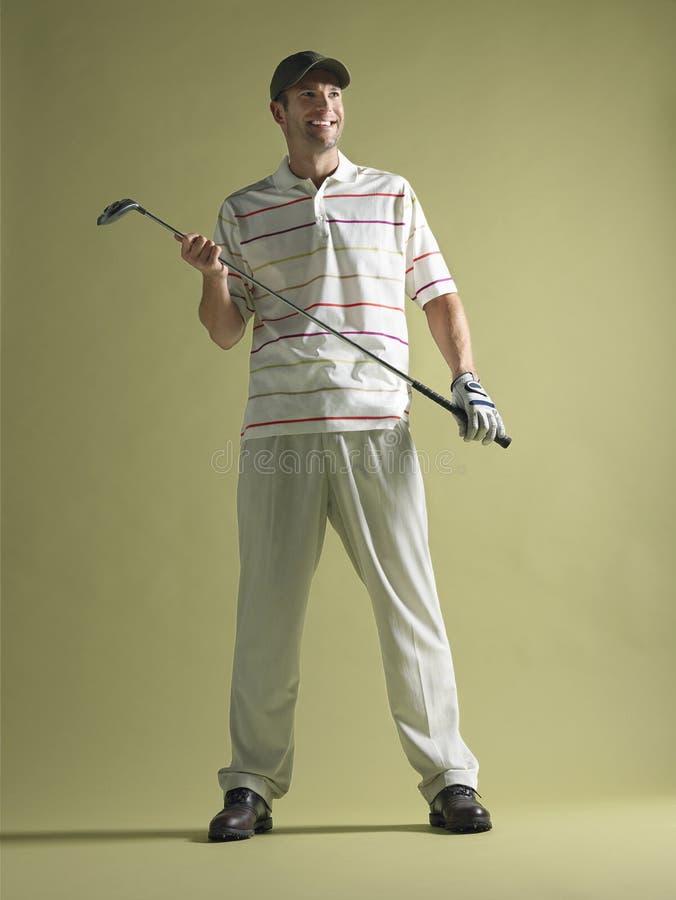 De mannelijke Club van de Golfspelerholding royalty-vrije stock foto's