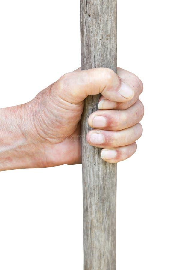 De mannelijke hand houdt oude houten stok stock foto