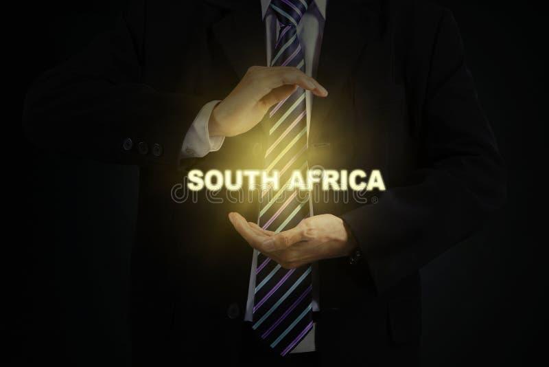 De mannelijke manager houdt het woord van Zuid-Afrika royalty-vrije stock fotografie