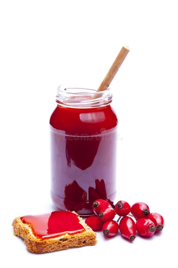 De marmelade van de rozebottel stock afbeeldingen