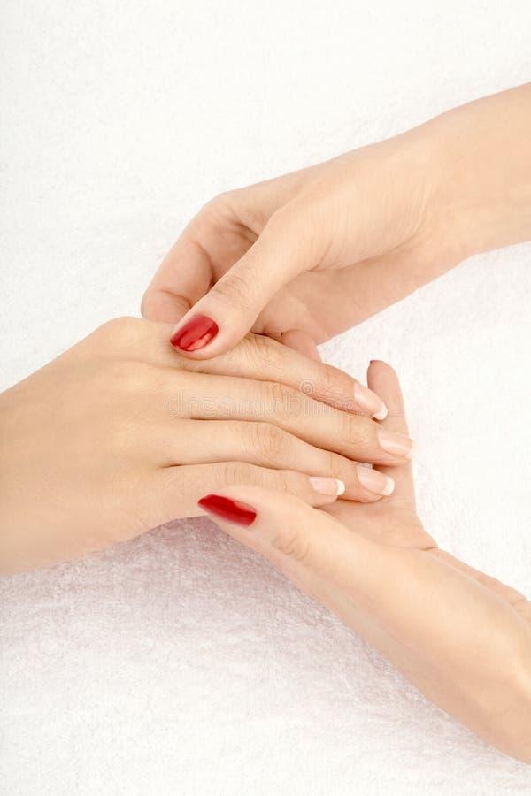 De massage van de hand stock afbeeldingen
