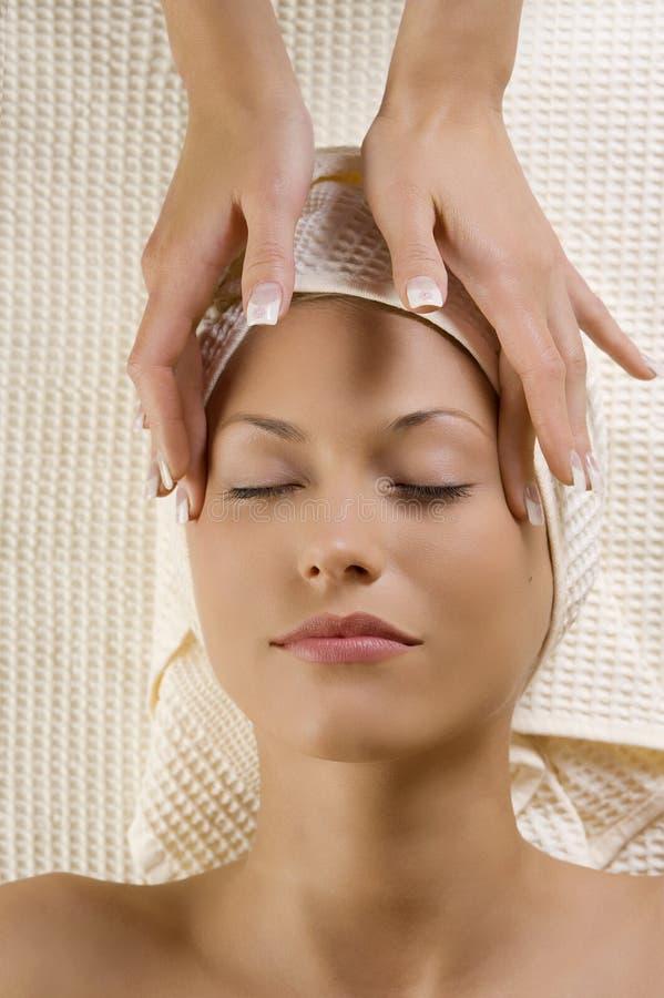 De massage van de hoofdpijn stock afbeelding