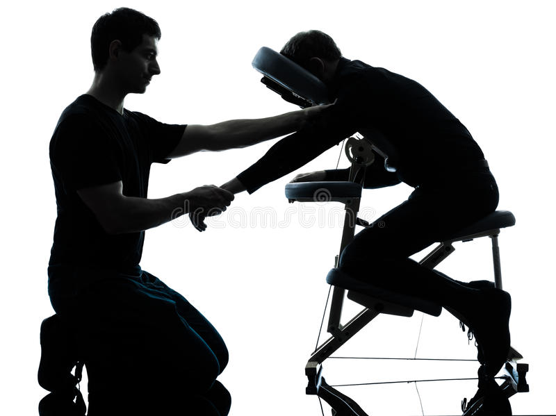 De massagetherapie van handenwapens met stoel stock fotografie
