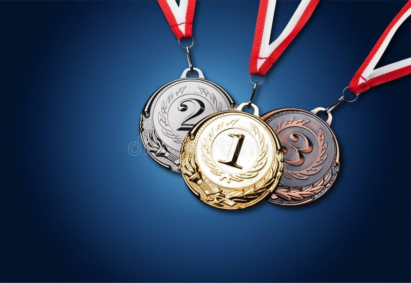 De medailles van het goud, van het zilver en van het brons met linten royalty-vrije stock foto's