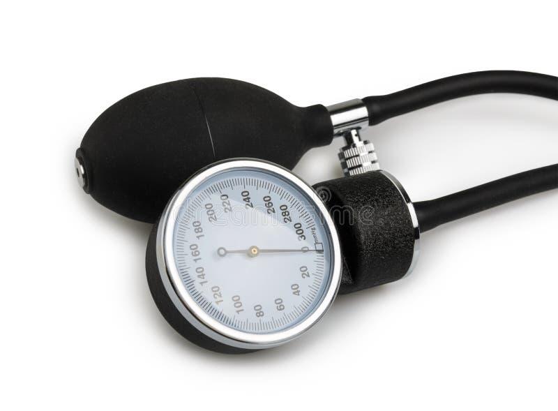 De medische apparatuur van de bloeddrukmeter op wit wordt geïsoleerd dat stock foto's