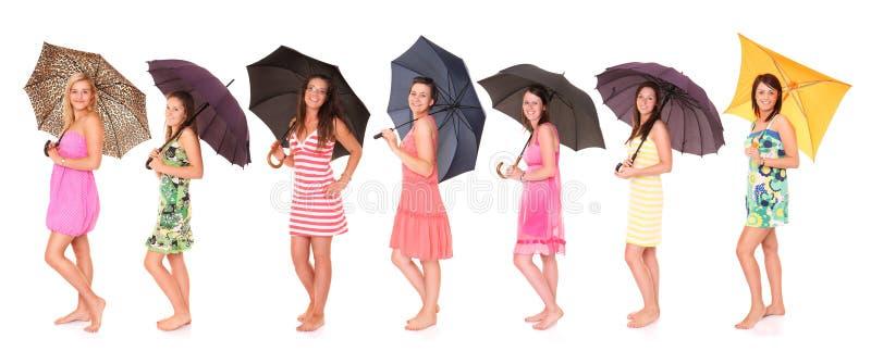 De meisjes van de paraplu stock afbeeldingen