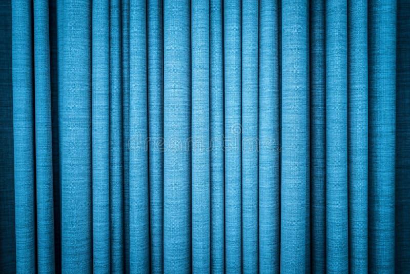 Blauw gordijn in vouwen. Geweven achtergrond. royalty-vrije stock fotografie