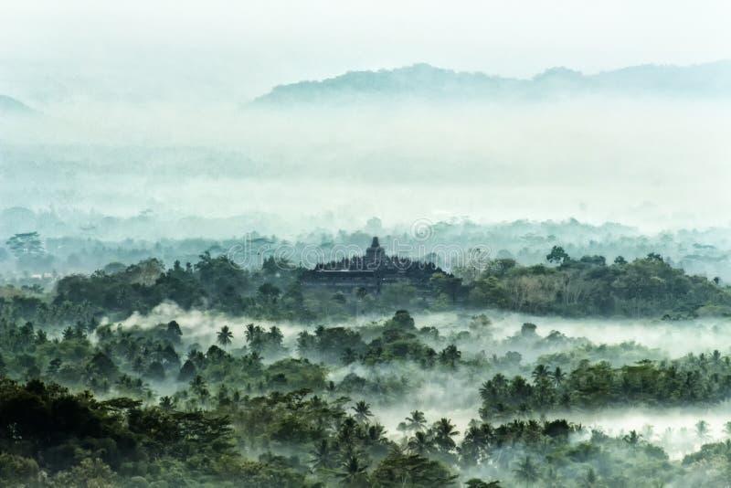 De mening van het zonsopganglandschap met borobudur van oude tempels, Magelang, Indonesië stock fotografie