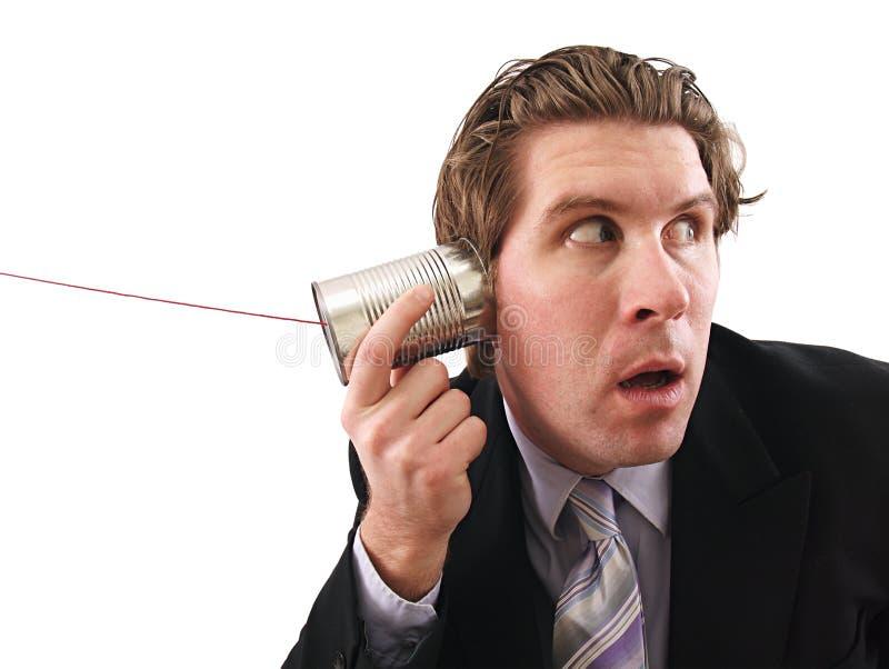 De mens die a gebruiken kan telefoneren royalty-vrije stock fotografie