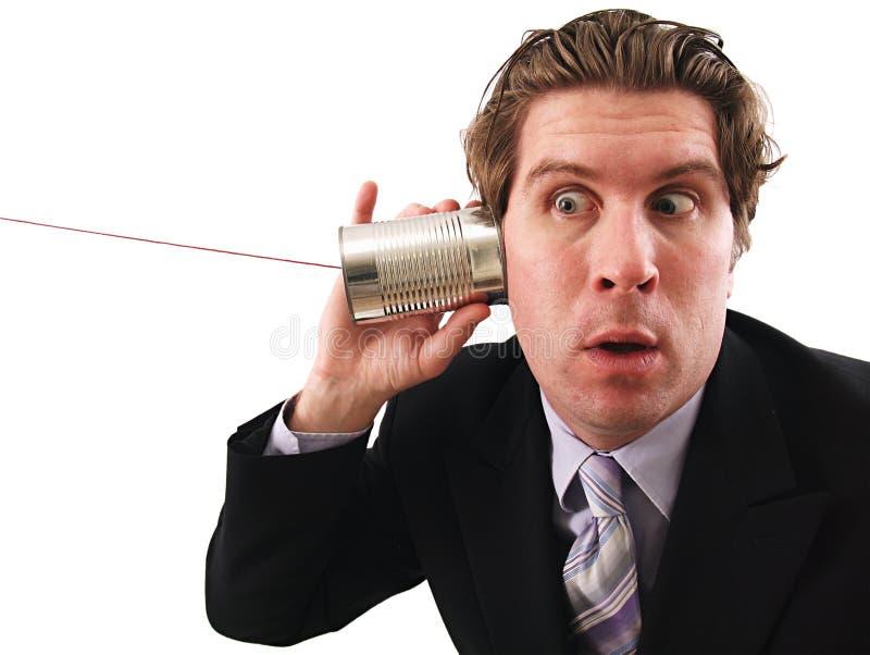 De mens die a gebruiken kan telefoneren royalty-vrije stock foto's