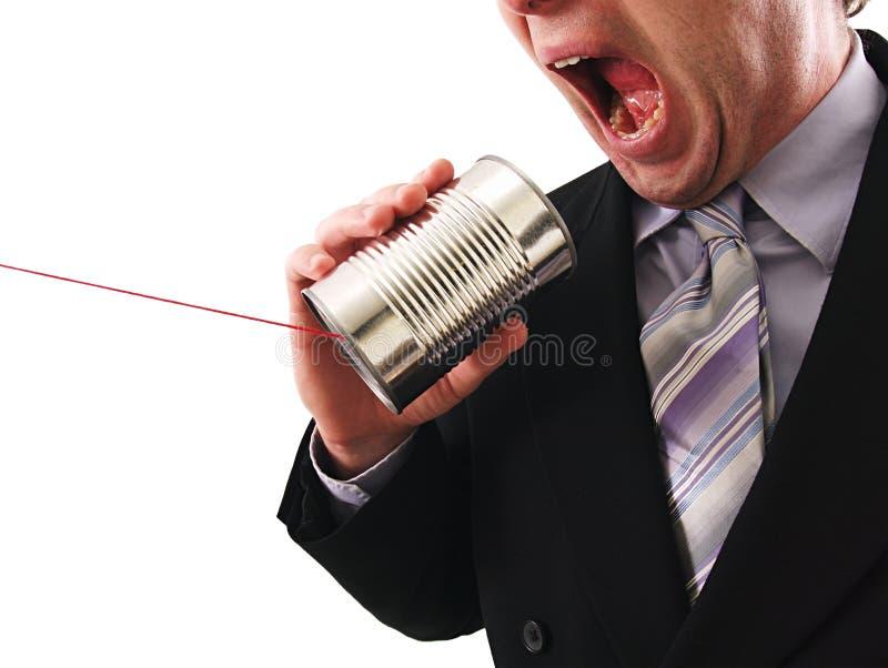 De mens die a gebruiken kan telefoneren stock foto