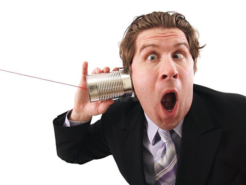 De mens die a gebruiken kan telefoneren stock fotografie