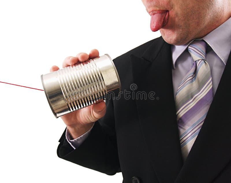 De mens die a gebruiken kan telefoneren royalty-vrije stock afbeelding