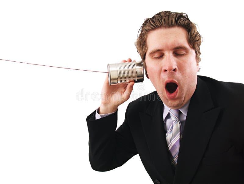 De mens die a gebruiken kan telefoneren stock afbeelding