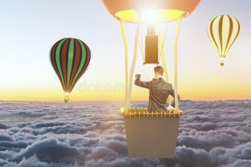 De mens die op een ballon vliegen en bekijkt de horizon royalty-vrije stock afbeelding
