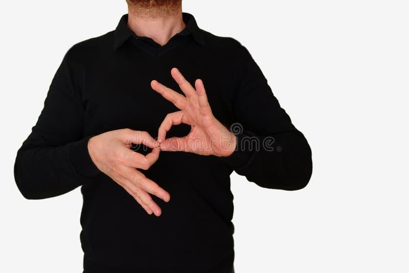 De mens die van de gebarentaaltolk een vergadering vertalen aan ASL, Amerikaanse Gebarentaal lege exemplaarruimte stock foto