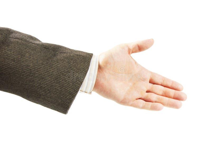 De mens in een kostuum bereikt van hem uitdeelt met open die palm voor handenschudden op wit wordt geïsoleerd royalty-vrije stock fotografie
