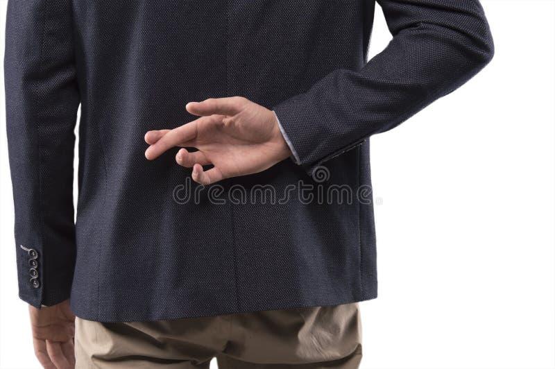 De mens in een kostuum kruiste zijn vingers achter zijn rug royalty-vrije stock fotografie