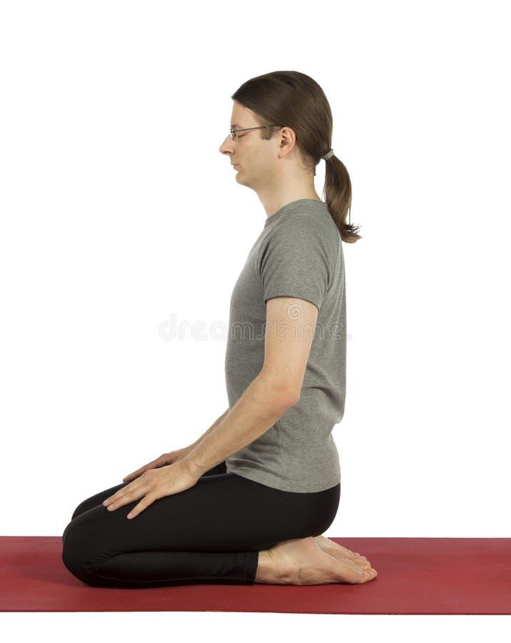 De mens in Held stelt in Yoga royalty-vrije stock afbeeldingen