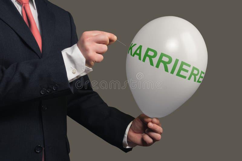 De mens in Kostuum laat een Droom met naald barsten stock foto's