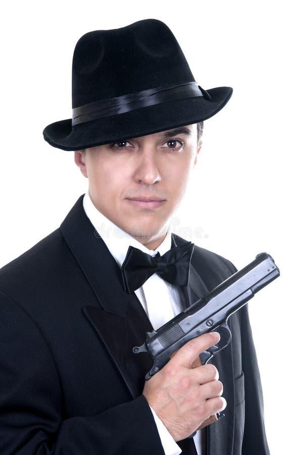 De mens in kostuum trekt uitstekend pistool royalty-vrije stock foto