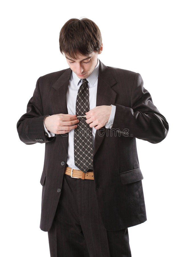 De mens in kostuum verbetert band stock afbeelding