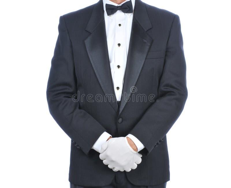 De mens in Smoking met dient Voorzijde van Lichaam in stock fotografie